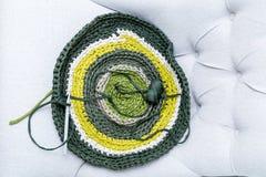 Knitting. Green Yellow circular knitting from above royalty free stock photo