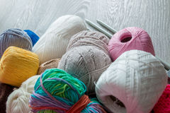 Knitting. Group of yarn and needles on grey wooden table. Close up. Copy space. Royalty Free Stock Image