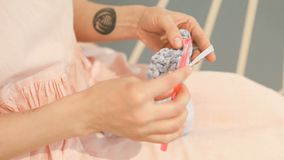 Knitting hand made hobby. Young woman hands with coll hipster tattoo working. Crochet knitting. Soft daylight. Video stock footage