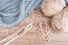 Knitting, handcraft. Knitting and yarn on wooden background. Handcraft. Vintage style with dark vignette and color filter warm tone Royalty Free Stock Photo