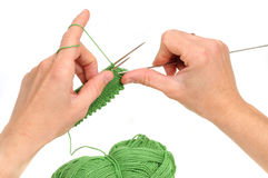 Knitting. Hands of a young woman knitting Stock Image