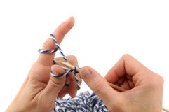 Knitting. Hands of a young woman knitting Stock Photo