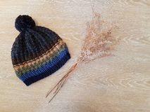 Knitting hat on wooden table Stock Image