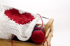 Knitting heart Stock Images