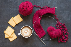 Knitting, heart, cup of coffee and crackers Stock Photos