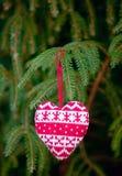 Knitting heart on fir-tree branch stock image