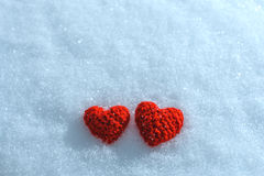 The knitting heart on a snowy background. Greeting card for Vale Stock Image