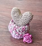 Knitting heart on wooden background. Crochet Golden Heart. Valentine`s Day, day card, background stock photo