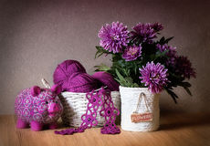 Knitting. Image of Balls for knitting, crochet hook, with flowers and a piggy bank Stock Photography