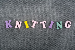 Knitting. Knitted Fabric Texture. Word composed from ABC alphabet letters. Knitting. Knitted Fabric Texture. Word composed from ABC alphabet letters royalty free stock photo