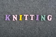 Knitting. Knitted Fabric Texture. Word composed from ABC alphabet letters. Knitting. Knitted Fabric Texture. Word composed from ABC alphabet letters stock images