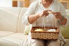 Knitting lady Stock Images