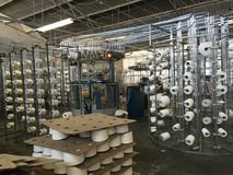 Knitting Machine & Creels in a Factory. Manufacturing of knitted cotton fabric in its raw state Stock Photography