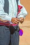 Knitting man in Peru. Man knitting a hat the traditional way at lake Titicaca on Taquile Island in Peru Royalty Free Stock Photo