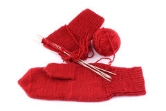 Knitting of a mitten from red threads Stock Photos