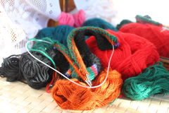 Knitting. Mix balls of multi-colored wool and spoke Royalty Free Stock Image