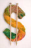 Knitting Money. Dollar sign made of colorful knitting yarn stock photos
