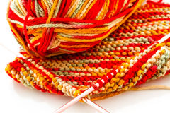 Knitting. With multi colored yarn with orange, red, and yellow tones Stock Photography