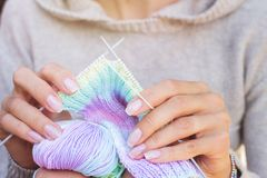 Knitting multicolored scarf stock photos