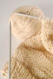 Knitting needle wool and fabric. Ball of wool with knitting needle and fabric Stock Photo