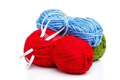 Knitting needle and yarns Stock Photos