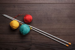 Knitting needles and ball of threads Royalty Free Stock Image