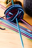 Knitting needles with ball of wool Royalty Free Stock Photography