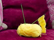 Knitting needles in ball of wool Stock Images