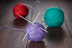 Knitting needles and balls of threads Stock Images