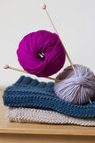 Knitting needles and balls of wool Stock Photos