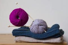Knitting needles and balls of wool Royalty Free Stock Photo