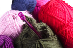 Knitting needles and balls of wool Royalty Free Stock Images