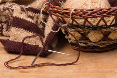 Knitting needles and basket Royalty Free Stock Images