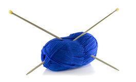 Knitting needles and blue wool Royalty Free Stock Photo