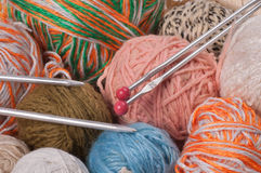 Knitting needles and colored thread Royalty Free Stock Photos