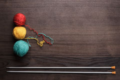 Knitting needles and colorful ball of threads Royalty Free Stock Photos