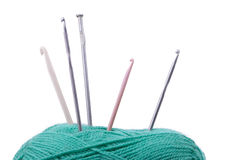 Knitting needles and crochet hook in ball Stock Photos