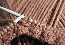Knitting needles with knitted stitches using brown wool Stock Photography