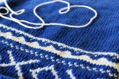 Knitting needles. Knitting plaid for a newborn baby Stock Photo
