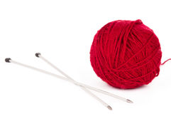 Knitting needles and red ball of yarn Stock Photography