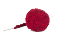 Knitting needles and red ball of yarn Royalty Free Stock Image