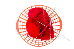Knitting needles, a red woolen thread Royalty Free Stock Photos