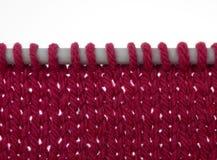 Knitting on needles, stocking stitch, over white Royalty Free Stock Photography