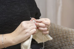 Knitting needles with the use of wool Stock Photo