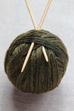 Knitting needles and wool ball Royalty Free Stock Photos