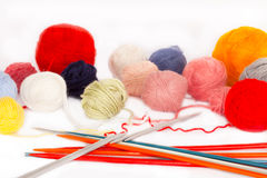 Knitting needles and wool balls Stock Photos