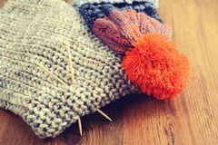 Knitting needles with wooly hat. winter cloth handemade Royalty Free Stock Images