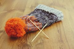 Knitting needles with wooly hat. winter cloth handemade Royalty Free Stock Photos