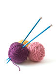 Knitting Needles and Yarn. Knitting Needles and three balls of yarn on a white background Stock Photos