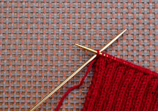 Knitting needles and yarn Stock Images
